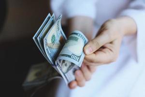 Dollars. Money in the hands