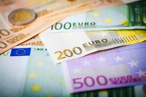 Closeup of euro banknotes and coins