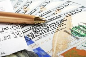 Business concept - money, pen and cash voucher