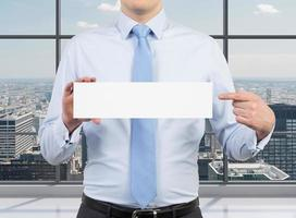 businessman holding placard