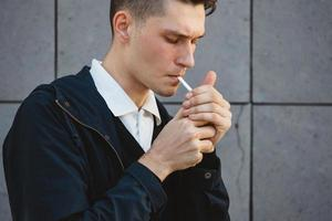 Fashion hipster male model smoking photo
