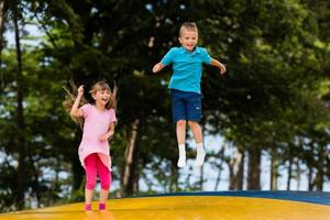 Kids at bouncy pillow photo
