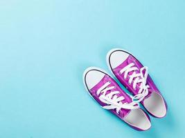 purple gumshoes with white shoelaces