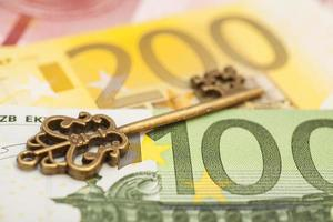 Key to success on different euro banknotes photo