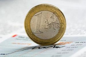 One euro coin on graph