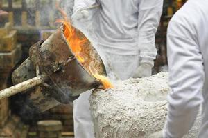 Ancient process metal cast photo