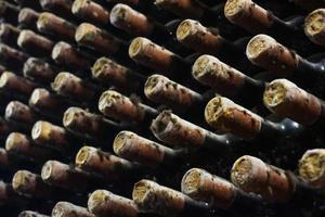 vineyard cellar with old bottles. photo