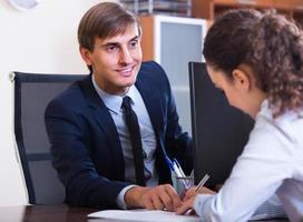 professional teaching new employee photo