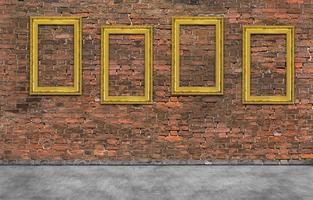 Golden frames on brick wall photo