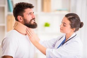 Injury man in doctor photo
