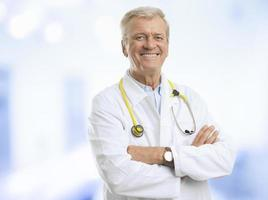 Smiling mature male doctor