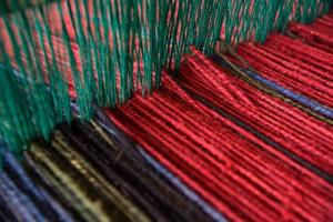 Wool yarn on loom photo
