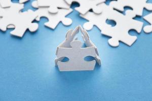 Three puzzle pieces as team photo