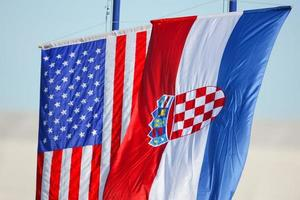 Croatian and American flags waving on white background photo
