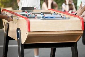 People playing table soccer. Pinball