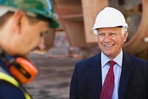 Businessman smiling on dry dock photo
