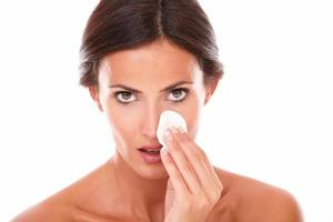 Mature latin woman pampering her face photo