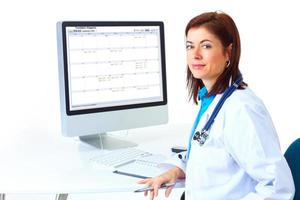 Female doctor sitting in front of computer screen