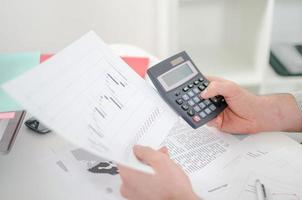 Businessman's hands with calculator photo