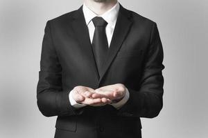 businessman begging gesture black suit photo