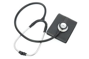 stethoscope above a wallet on white background