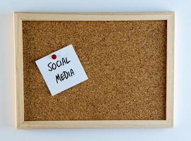 Social Media Pinned on Cork Bulletin Board photo