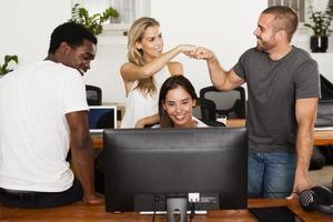 Technology startup team celebrates good news photo