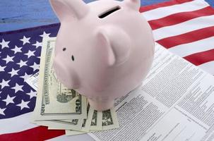 USA Tax Day concept with income tax form and cash