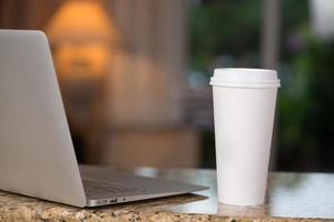 Lap top and coffee cup