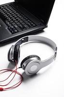 Computer white headphones on desk photo