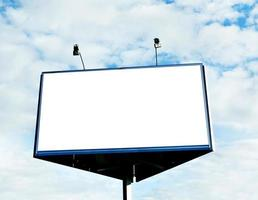 big blank billboard over cloudy blue sky