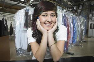 Owner With Hand On Chin Leaning At Laundry Counter photo