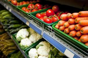 Various vegetables on display in grocery store photo