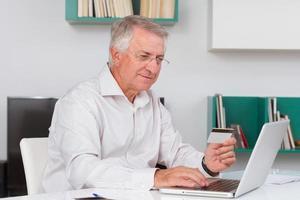Mature man doing online shopping