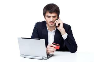 Businessman shopping online photo