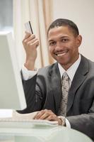 Businessman using credit card photo