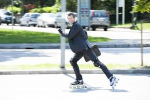 Excited Businessman Rollerblading