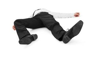 Businessman lying unconscious photo