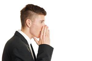 Businessman whispering photo