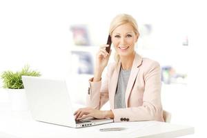 Businesswoman with laptop photo