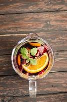 Orange and apple sangria on a wooden background photo