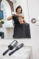 Hairdresser styling customers hair photo