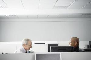 Business People Having Meeting In Office Cubicle photo