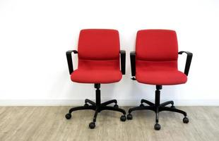 two red chairs in office photo