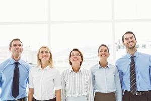 Business people looking up in office photo