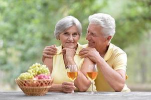 Elderly couple on nature photo
