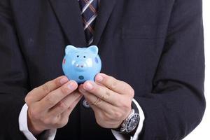 Businessman holding  Piggy bank officer put money inside