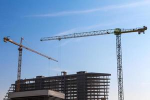 Building cranes on construction photo