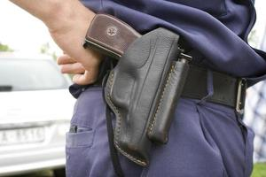 Police officer`s holster with gun.