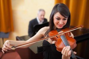 Woman playing violin photo